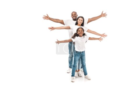 cheerful african american family imitating flying with outstretched hands on white background