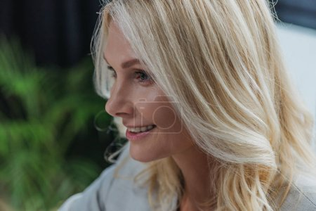 Photo for Portrait of attractive blonde businesswoman smiling in office - Royalty Free Image