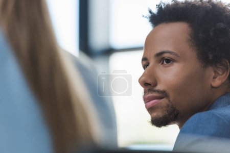 Photo for Selective focus of thoughtful african american businessman at business meeting - Royalty Free Image