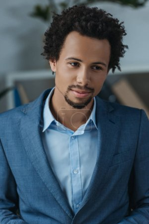 Photo for Young, thoughtful african american businessman in office - Royalty Free Image