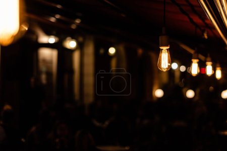 Photo for Selective focus of light bulbs with yellow lighting - Royalty Free Image