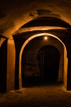 Photo for Arch and old walls in ancient basement at night - Royalty Free Image