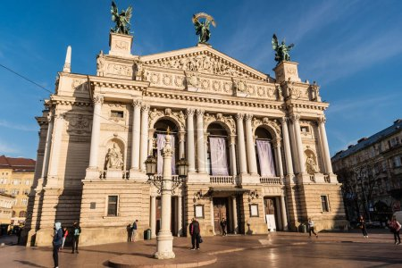 Photo for LVIV, UKRAINE - OCTOBER 23, 2019: Lviv Theatre of Opera and Ballet with people walking around - Royalty Free Image