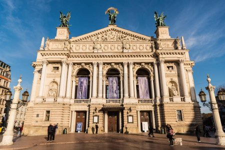 Photo for LVIV, UKRAINE - OCTOBER 23, 2019: front view of Lviv Theatre of Opera and Ballet with people walking around - Royalty Free Image