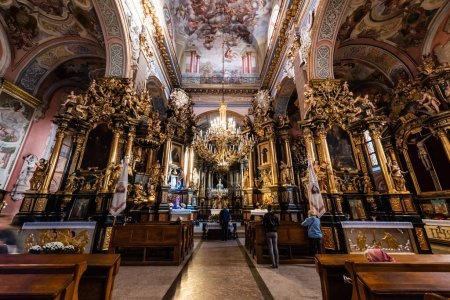 Photo for LVIV, UKRAINE - OCTOBER 23, 2019: interior of carmelite church with paintings, gilded columns and chandeliers - Royalty Free Image