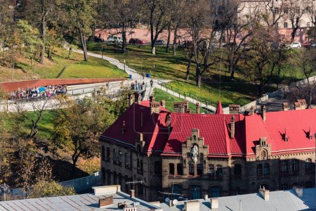 LVIV, UKRAINE - OCTOBER 23, 2019: aerial view of old fire department and people walking in park