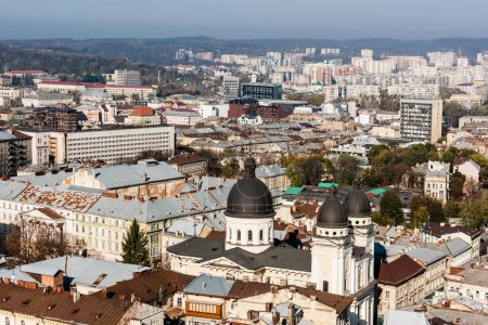 Photo for LVIV, UKRAINE - OCTOBER 23, 2019: aerial view of city with dominican church surrounded by old buildings - Royalty Free Image