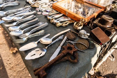 Photo for Stall on flea market with vintage cutlery, rusty keys, camera and souvenirs in lviv, ukraine - Royalty Free Image