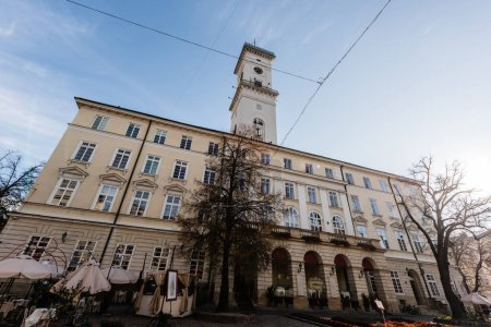 Photo for Facade of lviv city hall with tower against blue sky in lviv, ukraine - Royalty Free Image