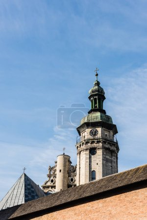 Photo for Korniakt tower and monastery wall against blue sky in lviv, ukraine - Royalty Free Image