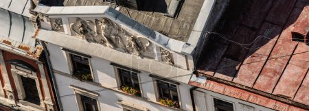 Photo for Aerial view of old house with sculptures on frontone in lviv, ukraine - Royalty Free Image