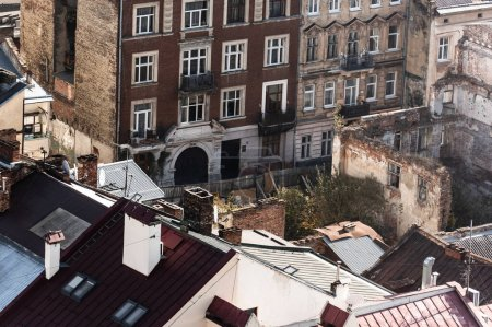 Photo for Aerial view of old buildings and trees near house ruins in lviv, ukraine - Royalty Free Image