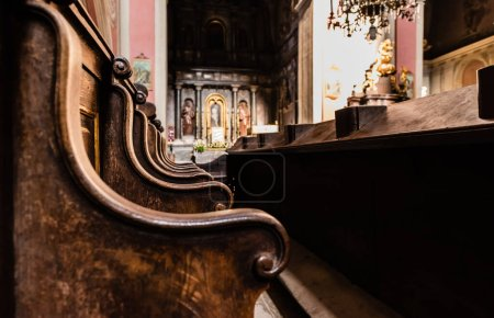 Photo for LVIV, UKRAINE - OCTOBER 23, 2019: selective focus of wooden benches in carmelite church - Royalty Free Image