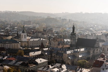 Photo for Aerial view of city hall tower and dormition church in historical center of lviv, ukraine - Royalty Free Image