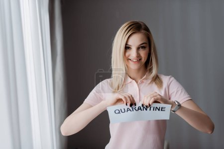 happy woman ripping paper with quarantine lettering