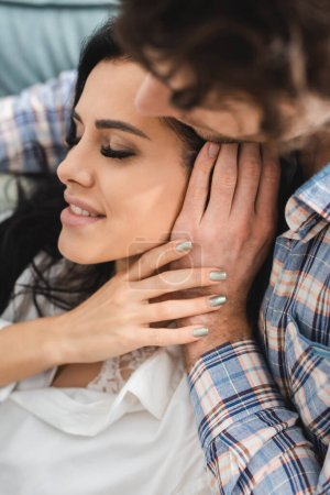 Photo for Overhead view of man touching beautiful smiling girlfriend with closed eyes - Royalty Free Image