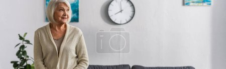 Photo for Website header of smiling senior woman looking away at home - Royalty Free Image