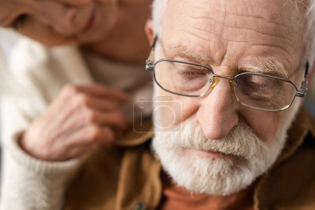 Photo for Selective focus of senior woman looking at husband, sick on dementia - Royalty Free Image