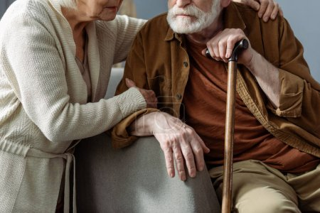 Photo for Cropped view of senior woman hugging husband, sick on dementia - Royalty Free Image