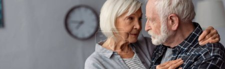 Photo for Panoramic crop of senior woman hugging husband, sick on dementia, while standing face to face - Royalty Free Image