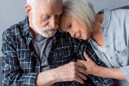 Photo for Senior woman hugging and leaning on old man with dementia disease - Royalty Free Image