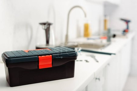 Selective focus of toolbox on worktop in kitchen