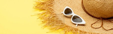 Photo for Straw hat and stylish suglasses on yellow background, panoramic shot - Royalty Free Image