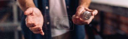 Photo for Horizontal crop of businessman spraying sanitizer on hand - Royalty Free Image