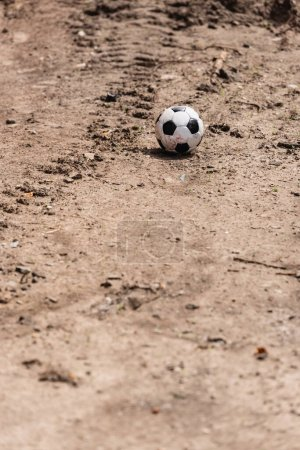 Photo for Selective focus of soccer ball on ground on urban street - Royalty Free Image