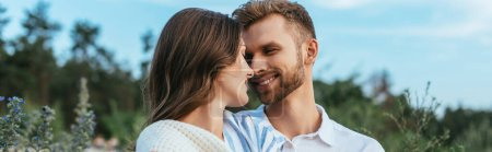 Photo for Horizontal image of happy couple smiling and looking at each other - Royalty Free Image