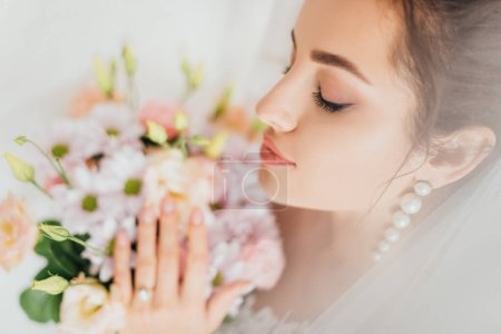 Photo for Selective focus of bride with closed eyes touching bouquet - Royalty Free Image