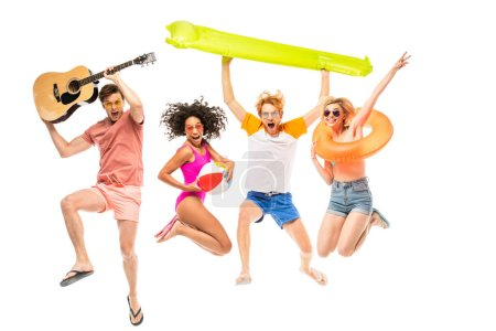 Excited multicultural friend in sunglasses holding inflatable ball and acoustic guitar while jumping isolated on white