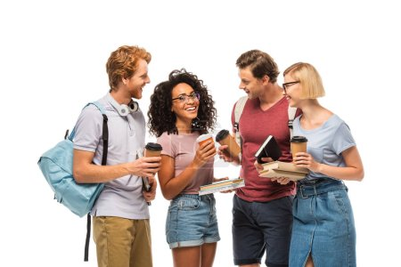 Students with coffee to go looking at african american friend with books isolated on white