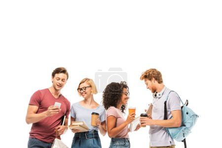 Photo for Multiethnic students holding coffee to go, books and smartphone isolated on white - Royalty Free Image