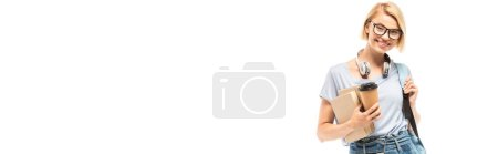 Panoramic orientation of student with books and coffee to go looking at camera isolated on white