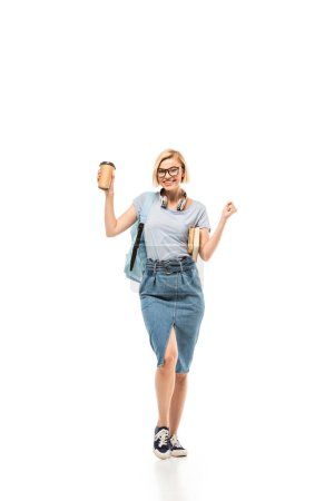 Student with books and coffee to go showing yeah gesture on white background