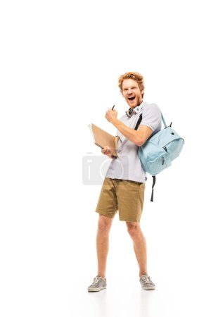 Student with backpack and notebook showing yeah gesture on white background