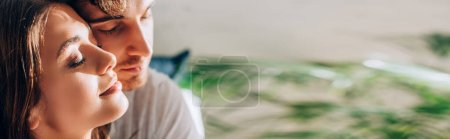 Photo for Horizontal crop of young couple with closed eyes - Royalty Free Image