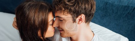 Photo pour Panoramic crop of couple embracing each other with closed eyes - image libre de droit