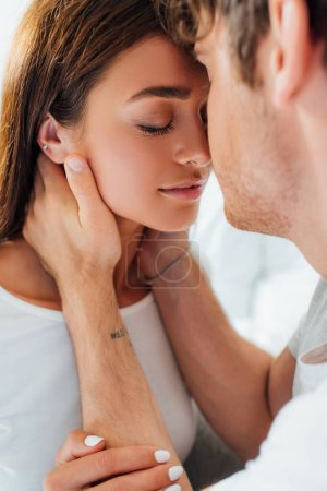 Photo for Selective focus of young woman touching boyfriend at home - Royalty Free Image