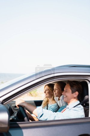 Photo for Selective focus of family traveling in car during weekend - Royalty Free Image