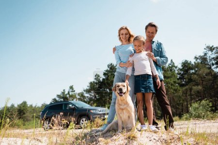 Photo for Selective focus of family looking at golden retriever during weekend - Royalty Free Image