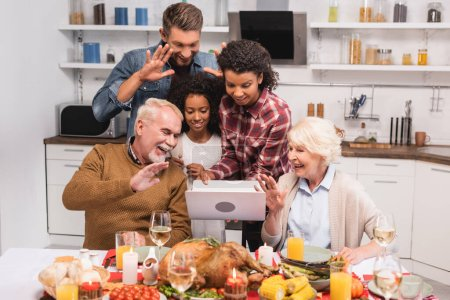 Photo for Selective focus of multiethnic family having video call on laptop during thanksgiving - Royalty Free Image