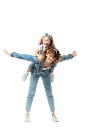 mother imitating plane with daughter on back isolated on white