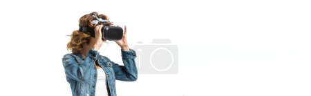 woman in denim outfit and virtual reality headset isolated on white, panoramic shot