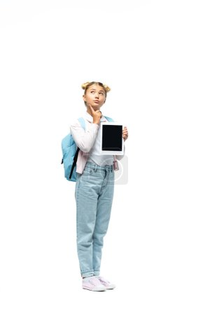 Thoughtful schoolchild holding digital tablet on white background