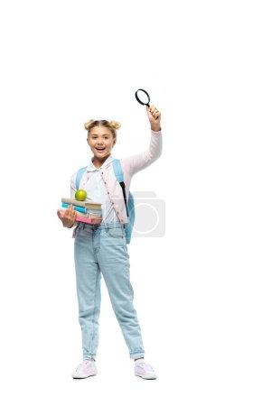 Photo pour Fille avec sac à dos tenant loupe et livres avec pomme sur fond blanc - image libre de droit