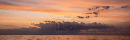 Horizontal crop of sky and sea during sunset