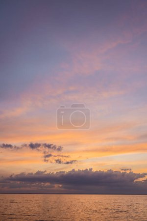 Landscape of sea and cloudy sky at sunset