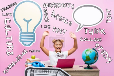 Photo for Schoolkid with raised hands sitting near gadgets, globe, illustration and paper artwork on pink - Royalty Free Image